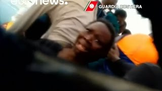 'You are safe.' Italian coastguard saves terrified migrants from sinking boat